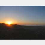 Sonnenaufgang am Strand vom Stellplatz Area Camper Su Giudeu